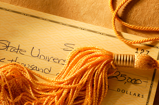 Paying「Gold tassel on a check written for college tuition」:スマホ壁紙(18)