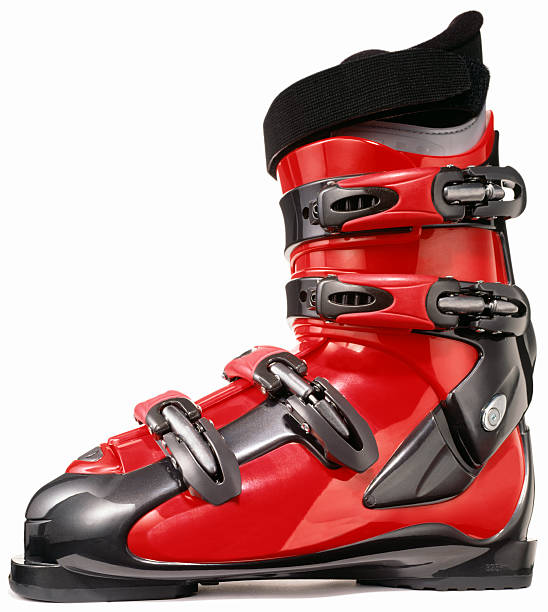 A profile of a single modern red ski boot:スマホ壁紙(壁紙.com)