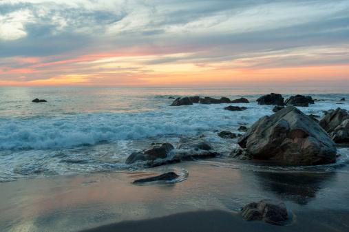 Sayulita「Water Washing Up On The Beach Around The Rocks At Sunset」:スマホ壁紙(12)