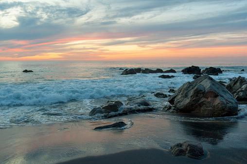 Sayulita「Water washing up on the beach around the rocks at sunset; sayulita mexico」:スマホ壁紙(6)