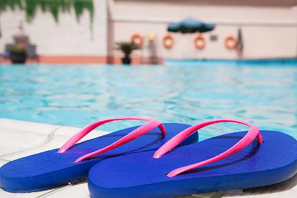 Pair of blue flip flops by the pool side:スマホ壁紙(壁紙.com)
