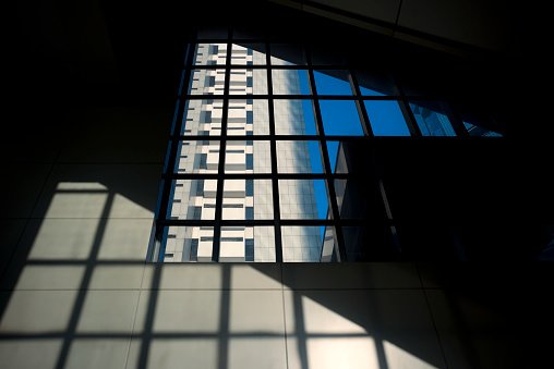 Conformity「Architectural abstract of large window, building, sky and shadow」:スマホ壁紙(19)