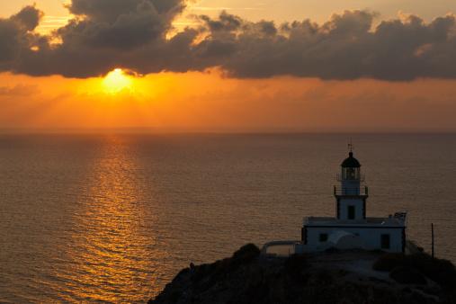 Aegean Sea「Europe, Greece, Cyclades, Thira, Santorini, Cliffs and lighthouse in Akrotiri at sunset」:スマホ壁紙(16)