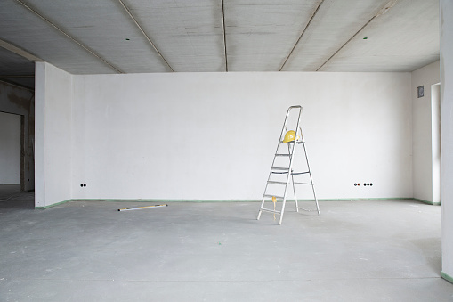 Germany「Ladder with hardhat against wall in renovating house」:スマホ壁紙(1)