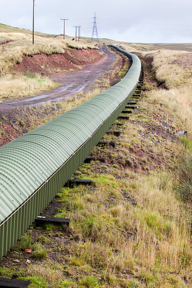 Unhygienic「A conveyor belt that takes coal from the Glentaggart open cast coal mine to a road head for onward transport by road in Lanarkshire, Scotland, UK. As well as the disastrous climate change consequences of continuing to mine and burn coal, living close to」:写真・画像(13)[壁紙.com]