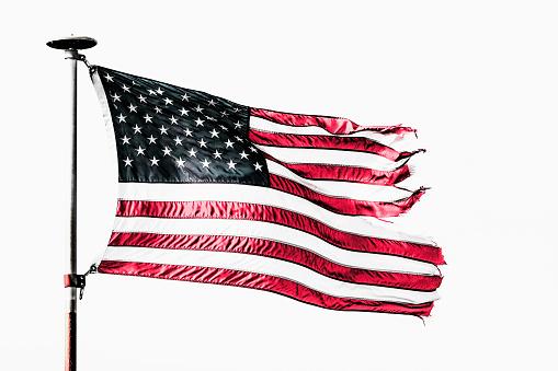 Pole「Tattered American flag flying from flagpole」:スマホ壁紙(2)