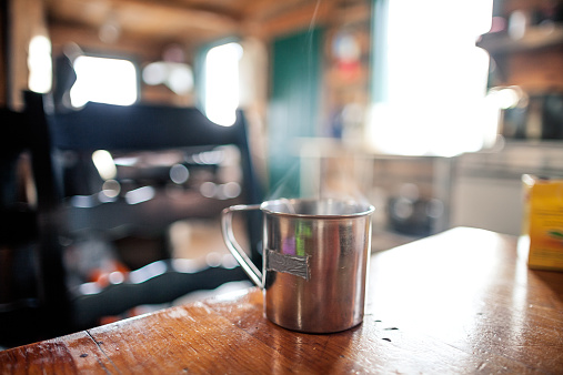 Chalet「Metal mug on the table at a mountain house.」:スマホ壁紙(1)