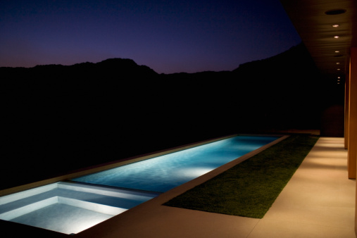 Calabasas「Exterior of modern house and swimming pool at night」:スマホ壁紙(3)