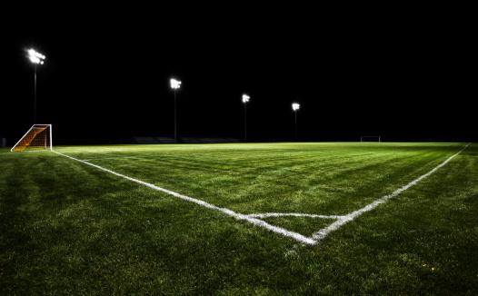 Floodlit「Empty soccer field at night with stadium lights on」:スマホ壁紙(12)