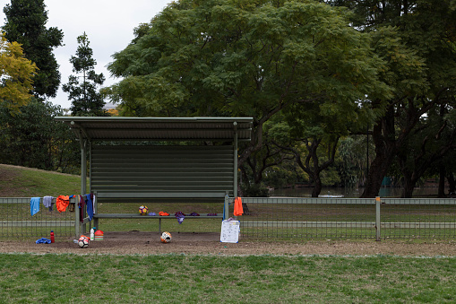 Women's Soccer「Empty soccer bench covered in sports gear during training」:スマホ壁紙(0)