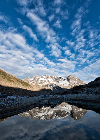 Passenger「Greenland, Sermersooq, Kulusuk, Schweizerland Alps, man standing at lake with mountains reflecting in water」:スマホ壁紙(4)