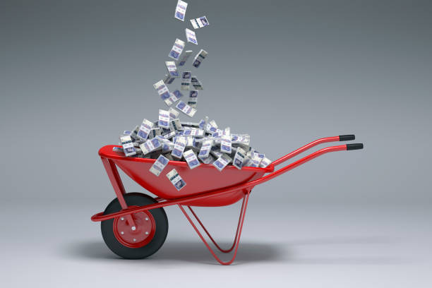 British pounds falling into red wheelbarrow:スマホ壁紙(壁紙.com)