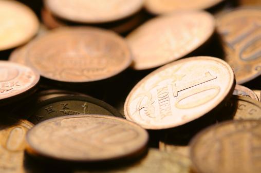 Economic fortune「macro shot of golden coins」:スマホ壁紙(5)