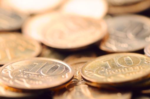 Economic fortune「macro shot of golden coins」:スマホ壁紙(4)
