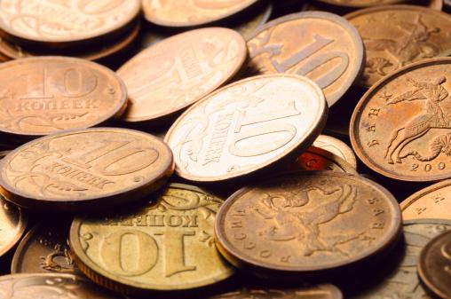 Economic fortune「macro shot of golden coins」:スマホ壁紙(19)