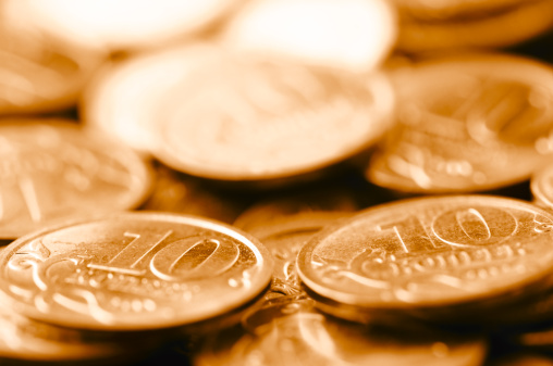 Economic fortune「macro shot of golden coins」:スマホ壁紙(18)