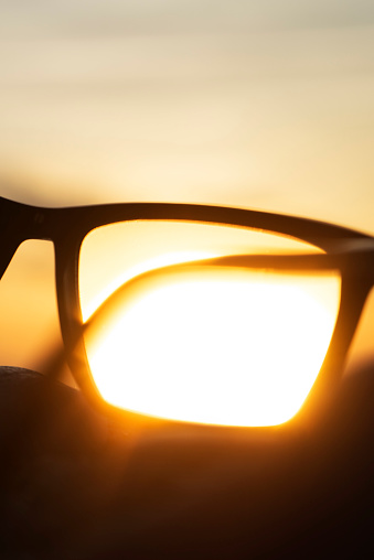 Eyesight「A series of abstract images of black rimmed reading glasses at sunset with selective focus」:スマホ壁紙(13)