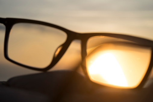 Eyesight「A series of abstract images of black rimmed reading glasses at sunset with selective focus」:スマホ壁紙(18)