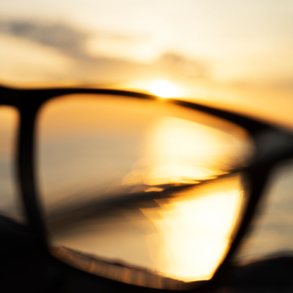 Eyesight「A series of abstract images of black rimmed reading glasses at sunset with selective focus」:スマホ壁紙(6)