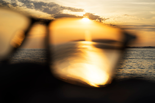 Eyesight「A series of abstract images of black rimmed reading glasses at sunset with selective focus」:スマホ壁紙(7)
