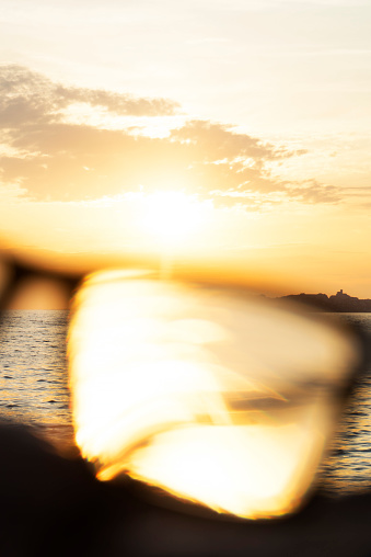Eyesight「A series of abstract images of black rimmed reading glasses at sunset with selective focus」:スマホ壁紙(14)