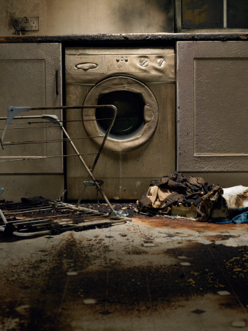 Misfortune「Fire damaged kitchen with washing machine and upturned clothes horse」:スマホ壁紙(4)