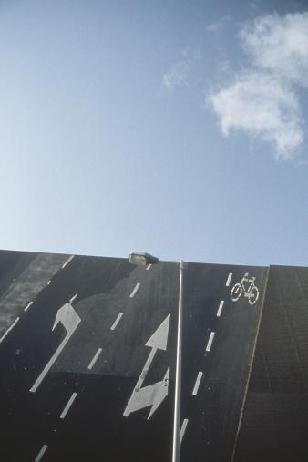 Steep「Painted traffic symbols on a road」:スマホ壁紙(2)