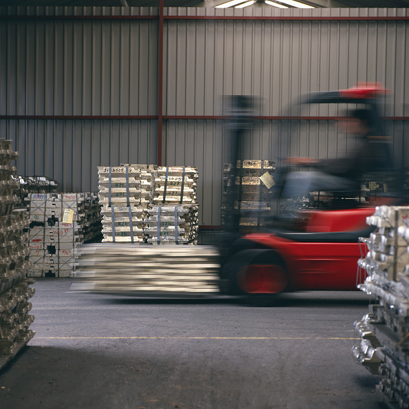 Finance and Economy「Fork Lift Truck moving materials in metal warehouse, Holland.」:写真・画像(4)[壁紙.com]