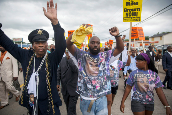 Missouri「Rally Held in Ferguson Over Police Killing Of Michael Brown」:写真・画像(14)[壁紙.com]