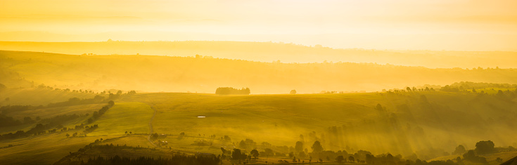 Beauty In Nature「Glorious golden sunrise over idyllic rural hills summer pasture panorama」:スマホ壁紙(14)