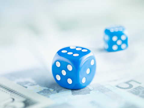 Economic fortune「Two blue dice on pile of euro notes」:スマホ壁紙(15)