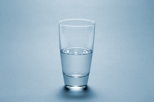 Drinking Glass「Half full water glass over blue background」:スマホ壁紙(10)