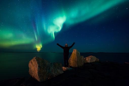 Passenger「Norway, Lofoten Islands, Eggum, back view of man standing on rock admiring Northern lights」:スマホ壁紙(7)