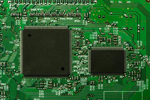 Mother Board「Microprocessors on a back lit circuit board」:スマホ壁紙(4)