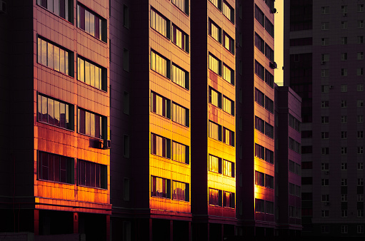 Twilight「Modern color multi-stored building. Sunlight shining at glass wall」:スマホ壁紙(3)