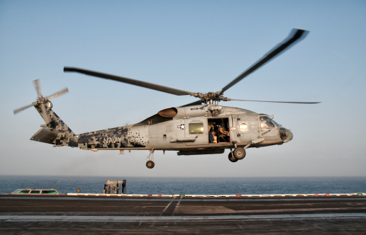 Arabian Sea「A US Navy SH-60F Seahawk hovers above the flight deck of USS Eisenhower. 」:スマホ壁紙(19)
