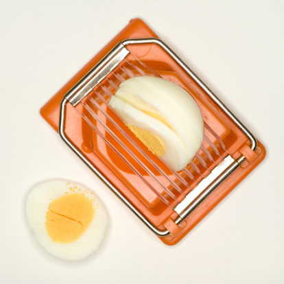 Hard-Boiled Egg「Boiled egg in egg slicer, elevated view」:スマホ壁紙(16)