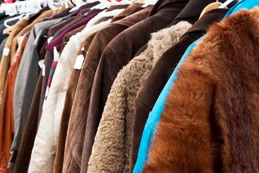 Rack「Closeup secondhand winter coats and jackets hanging in shop」:スマホ壁紙(13)