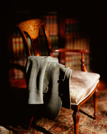Jacket「Jacket hanging over arm of wooden chair」:スマホ壁紙(10)