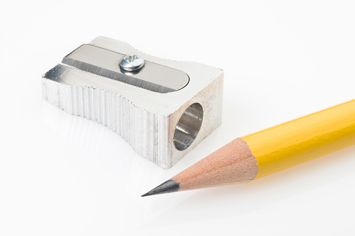 Sharpening「Yellow pencil tip and sharpener on white background」:スマホ壁紙(1)