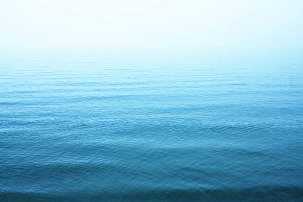 Ripples on blue water surface:スマホ壁紙(壁紙.com)