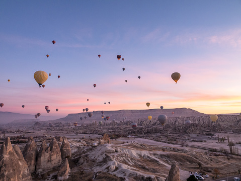 Turkey - Middle East「Hot air balloons flying in red and rose valley in Goreme in Cappadocia in Turkey」:スマホ壁紙(13)