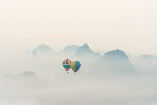 Hot air balloon ride at dawn over Karst mountains:スマホ壁紙(壁紙.com)