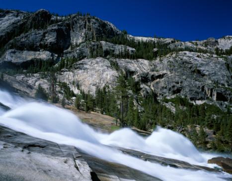 Steep「Pine trees dot mountainous landscape behind frothy waterwheels on river. LeConte Falls, Tuolumne River, Tuolumne Meadows, Yosemite National Park, California.」:スマホ壁紙(15)