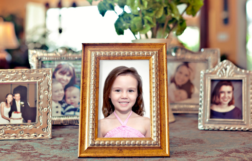 Family「Young girl's picture in a frame with others behind」:スマホ壁紙(2)