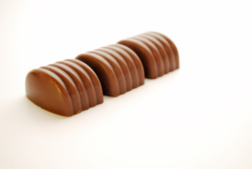 Milk Chocolate「cube chocolate candies. Closeup」:スマホ壁紙(17)