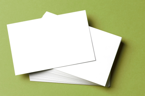 Paperwork「Pile of blank white cards on a green surface/background」:スマホ壁紙(2)