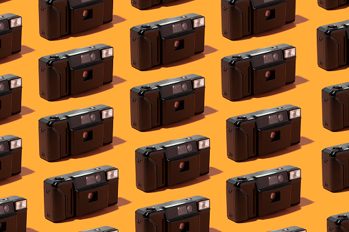 Equality「Plastic photo cameras organized in a row over orange background」:スマホ壁紙(7)
