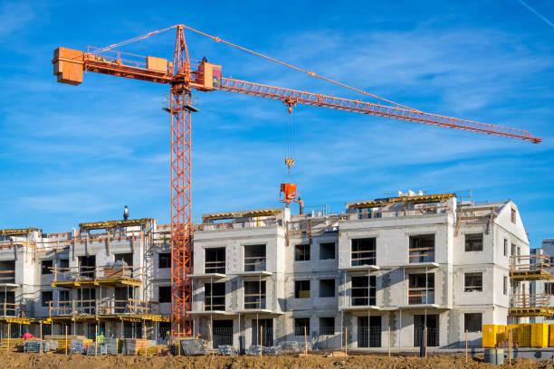 New complex of apartment buildings under construction:スマホ壁紙(壁紙.com)