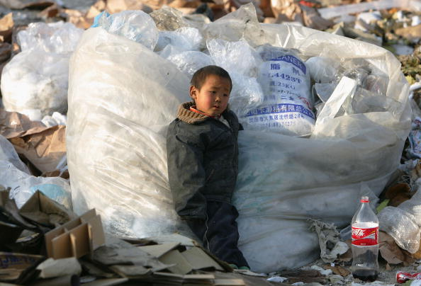 Clothing「Migrant Workers Call Refuse Dump Home」:写真・画像(13)[壁紙.com]